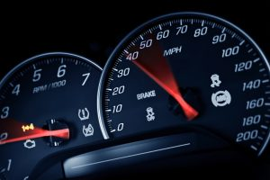 Sporty Speedometer. Sports Car Instruments Dash/Panel Closeup. RPM and Speed Metering. Transportation Photo Collection.
